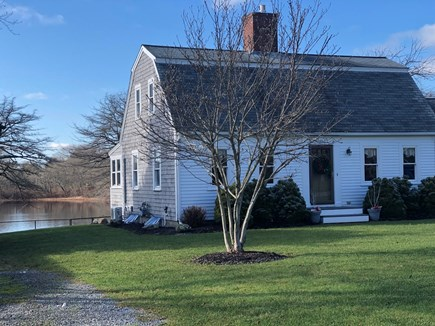 Falmouth. Walk to town   Short Cape Cod vacation rental - Enjoy the spacious front yard and back yard on Nye Pond