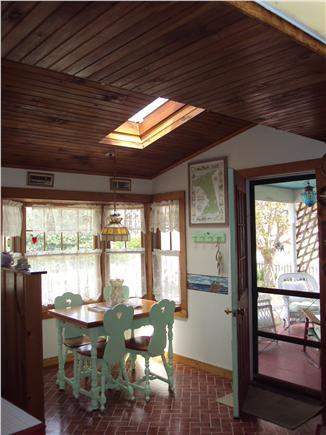 Dennisport Cape Cod vacation rental - Sunny breakfast nook with peek at open porch