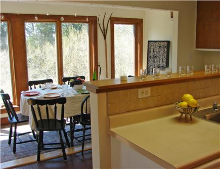 East Orleans Cape Cod vacation rental - Open kitchen and dining area with views of flowering yard