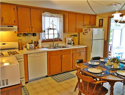 South Dennis Cape Cod vacation rental - Kitchen area with new appliances and dining for six