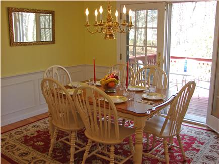 South Yarmouth Cape Cod vacation rental - Dining area welcomes six people, French doors to deck