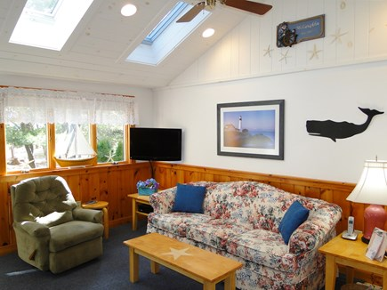 So. Chatham Cape Cod vacation rental - Living room with four skylights & flat screen TV