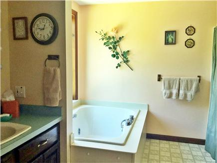 North Truro Cape Cod vacation rental - Master bath with jet tub and shower, washer and dryer.