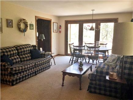 Truro Cape Cod vacation rental - 1st floor living/dining area with lower deck.