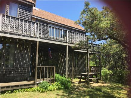 North Truro Cape Cod vacation rental - Upper and lower decks along with a picnic area by the gas grill.