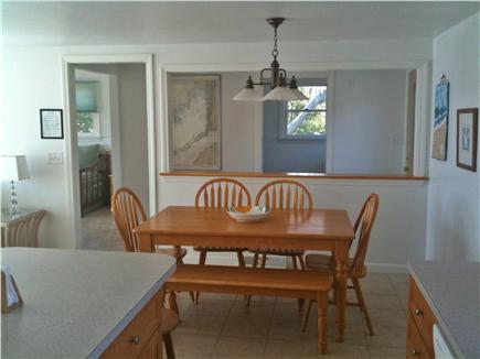 Bourne, Cataumet, Scraggy Neck Cape Cod vacation rental - Kitchen and Dining Room with space for guests, window A/C.