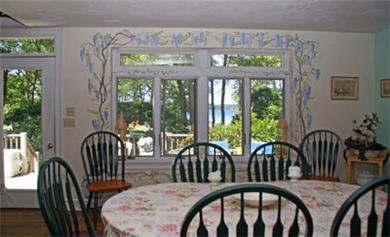 Harwich Cape Cod vacation rental - Dining room looks over patio to water views