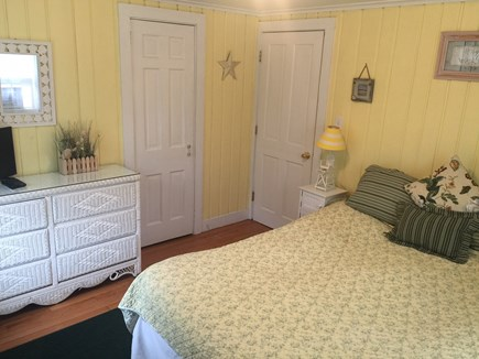 Hyannis Port Cape Cod vacation rental - Yellow ''Sunshine'' queen bedroom. View of garden on 2 sides.