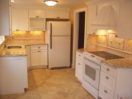 Hyannis Port Cape Cod vacation rental - All-new cheery, bright kitchen overlooks patio & fenced yards.