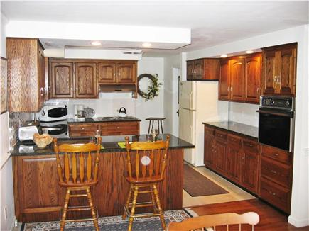 North Chatham Cape Cod vacation rental - Custom kitchen with Island eating area