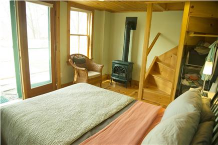 Wellfleet Cape Cod vacation rental - Downstairs bedroom; opens onto patio; gas fireplace