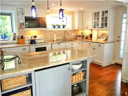 Barnstable Village Cape Cod vacation rental - Gorgeous kitchen connects to the screened breezeway and back deck