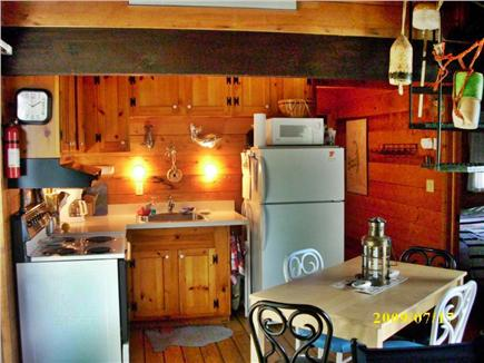 South Wellfleet Cape Cod vacation rental - Kitchen area, Spiral stairs to loft on right
