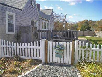 Yarmouth Cape Cod vacation rental - Gate to the backyard & deck area that is all fenced in (stockade)