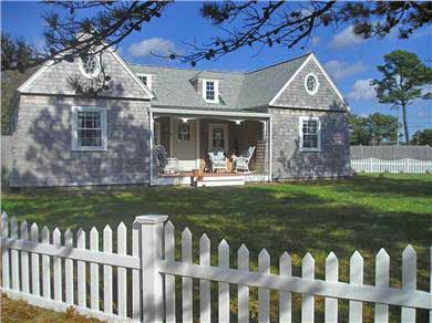 Yarmouth Cape Cod vacation rental - Front porch with wicker rockers in totally fenced in front yard