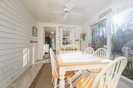 Brewster Cape Cod vacation rental - Breakfast/Sunroom -sliders open to outdoor dining area, rear yard