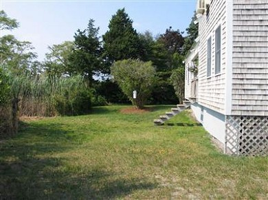 Barnstable Village Cape Cod vacation rental - Backyard, steps up to back deck, picnic table & grill (not shown)