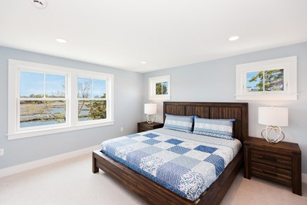 Barnstable Village Cape Cod vacation rental - One of two master suites, windows look west over the marsh