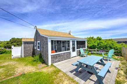 Dennis Port Cape Cod vacation rental - Front patio and full backyard!