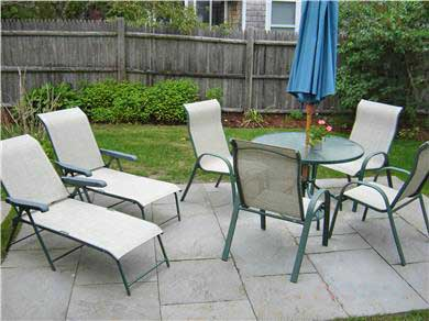 West Dennis Cape Cod vacation rental - Fenced back yard with patio