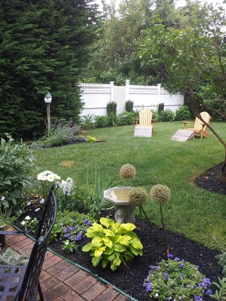North Chatham Cape Cod vacation rental - Private back yard for dining and relaxing.