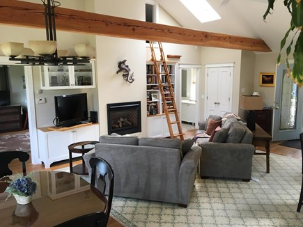 Chatham Cape Cod vacation rental - Opposite view of Living Rm, gas fireplace & ships ladder to loft