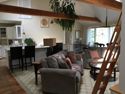 Chatham Cape Cod vacation rental - Living Room, open kitchen rear left with counter and barstools