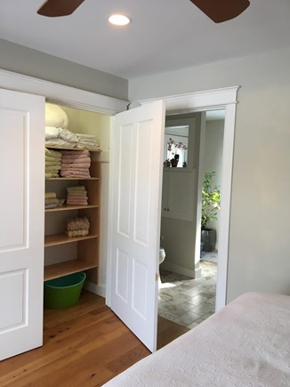 Chatham Cape Cod vacation rental - Master bedrm 2 door closet & bath towels, door into bath room