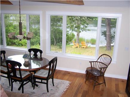 Chatham Cape Cod vacation rental - Pond Side Dining with row boat at water's edge