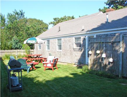 Harwich Port Cape Cod vacation rental - Fenced back yard w/ dining area, grill & hot/cold outdoor shower
