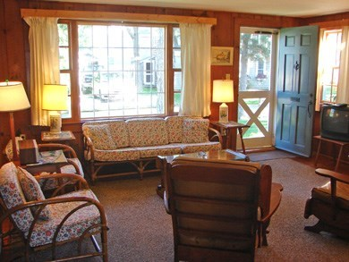 Harwich Port Cape Cod vacation rental - Spacious bright living room with fireplace and bay window