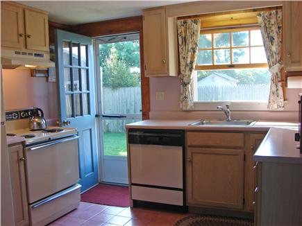 Harwich Port Cape Cod vacation rental - Kitchen adjacent to screened porch and door to back yard