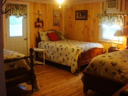 Dennis Cape Cod vacation rental - Bedroom 2 with Queen, Full, and twin beds, AC unit