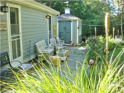 Dennis Cape Cod vacation rental - Backyard door from each bedroom leading to garden and shower