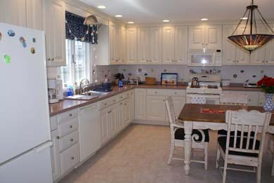 Mashpee Cape Cod vacation rental - Kitchen opens to dining and living areas