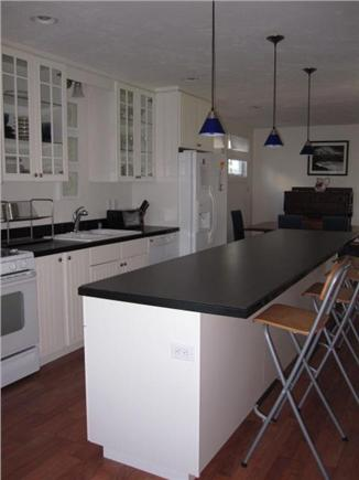 Dining for 12!!  11 ft island - modern kitchen- fully stocked! in a Onset vacation rental Just off Cape