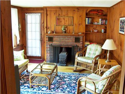 Dennis Port Cape Cod vacation rental - Living Room with traditional knotty pine walls and Cable TV.