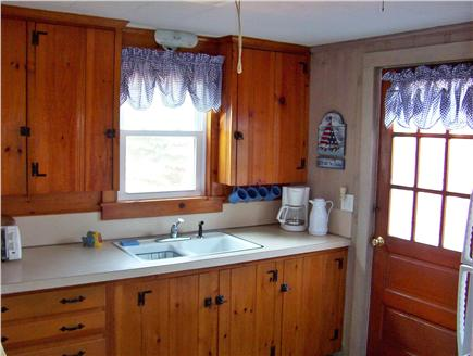 Dennis Port Cape Cod vacation rental - Kitchen - Door opens out onto backyard brick patio & shower area!