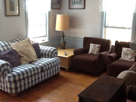 Wellfleet Cape Cod vacation rental - Living Room with love seat, four chairs, desk and large TV.