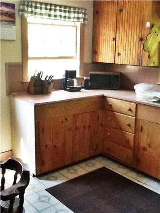 Wellfleet Cape Cod vacation rental - Kitchen with New Microwave, coffee maker, table, grill outside.