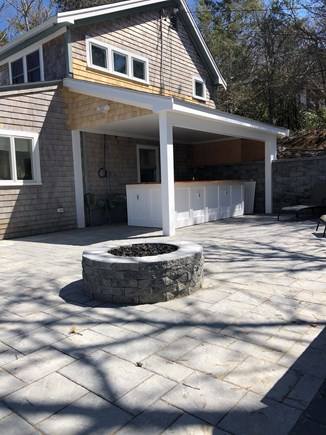 West Falmouth Cape Cod vacation rental - Outdoor patio with an gas firepit, outdoor bar, and pizza oven.