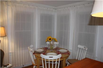 Brewster-North of 6A Cape Cod vacation rental - Morning breakfast table in beautiful porch area!!