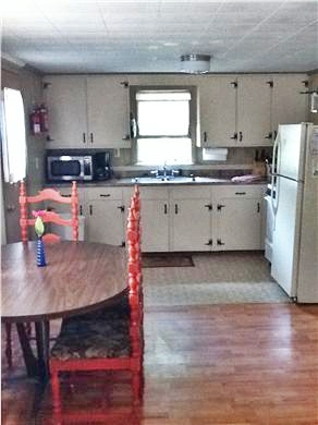 Wellfleet Cape Cod vacation rental - Cottage #1 kitchen opens to patio dining area
