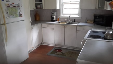 Wellfleet Cape Cod vacation rental - Open kitchen with all amenities, slider to deck,views of the bay
