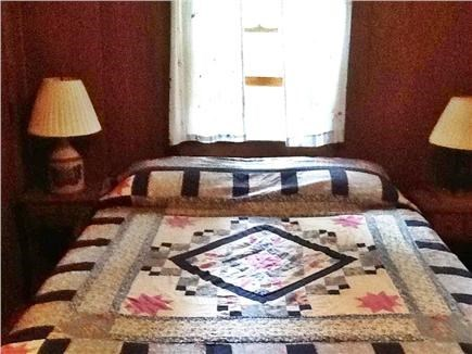 Wellfleet Cape Cod vacation rental - First floor queen corner bedroom, windows toward the woods