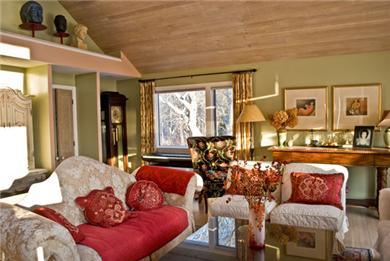 Chatham Cape Cod vacation rental - South wing Sitting room with cathedral ceilings & dining area