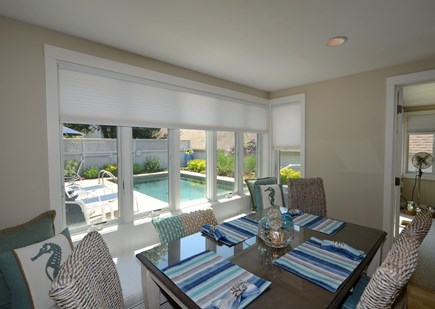 New Seabury, Mashpee New Seabury vacation rental - Dining area with built-in bench and pool view.