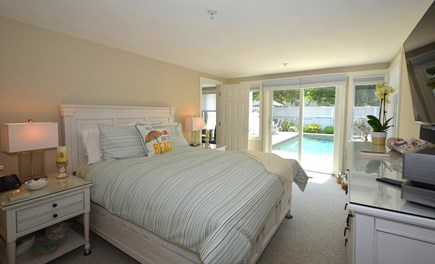 New Seabury, Mashpee New Seabury vacation rental - First floor Master Bedroom with slider to pool and patio.