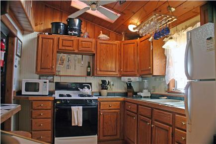Onset MA vacation rental - Kitchen area (sit down island to the left)