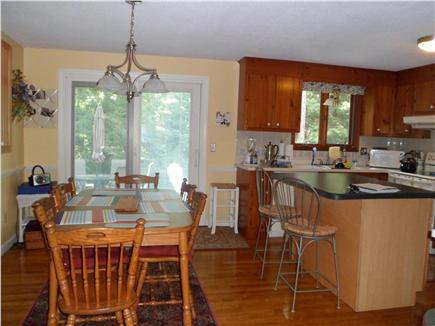 Yarmouthport Cape Cod vacation rental - Spacious kitchen with island and dining table, microwave, D/W